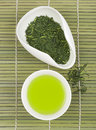 Set of green tea for tea ceremony on bamboo mat Royalty Free Stock Photography