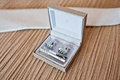 Set of groom cuff links on silver box Royalty Free Stock Images