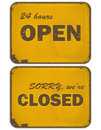 Set of grunge yellow signs: open - closed Stock Images