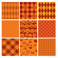 Set of Halloween plaid seamless patterns in orange Royalty Free Stock Photo