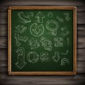 Set of hand drawn doodle arrows on a green chalkboard vector illustration eps Stock Photography