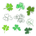 Set hand-drawn leaf clover in green colors. Three and Four leaf,