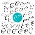Set of Hand drawn vector calligraphy letter C. Script font. Isolated letters written with ink. Handwritten brush style Royalty Free Stock Photo