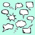 Set of hand drawn vector comical speech bubbles with etching in sketch style Stock Photography