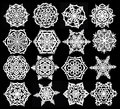 Set of hand made cut out white snowflakes on black paper background Stock Photos