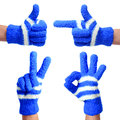 Set of hands in knitted blue gloves isolated thumb up pointing victory ok sign on white Royalty Free Stock Image