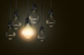 Set of hanging realistic bulbs on dark background