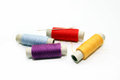 Set of hanks of multi colored threads for sewing on a white background Stock Image