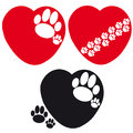 Set of hearts with dog paws on white background