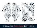 Set of heraldic flourish patterns Royalty Free Stock Photo