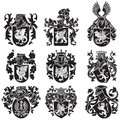 Set of heraldic silhouettes no vector image black medieval executed in woodcut style isolated on white background blends gradients Royalty Free Stock Photos