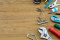 Set of home manual tools on wooden background with copy space Stock Images