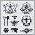 Set of honey labels, badges and design elements. Honeycombs, bees, honey emblems.