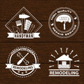 Set of house renovation labels and home remodeling logos. Handyman logo on wooden background.
