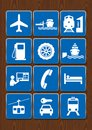 Set icons of airport, gas station, port, train station, cable car, mechanics. Icons in blue color on wooden background