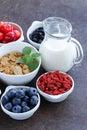 Set of ingredients for a healthy food breakfast - muesli, fresh and dried fruit, nuts, goji