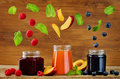 Set of jams with flying slices: raspberry, blueberry and peach Royalty Free Stock Photo