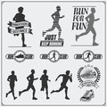 Set of jogging and running club labels, emblems and design elements. Silhouettes of runners. Royalty Free Stock Photo