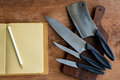 Set of kitchen knifes on wooden cutting board Royalty Free Stock Photo