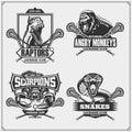 Set of lacrosse badges, labels and design elements. Sport club emblems with lion, cobra, raptor dinosaur and scorpion.