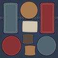Set of leather labels on denim