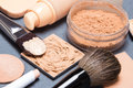Set of makeup products to even out skin tone and complexion accessories shallow depth field Stock Images