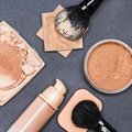 Set of makeup products to even out skin tone and complexion concealer corrector open cream foundation bottle jar loose powder Royalty Free Stock Photography