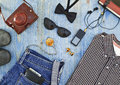 Set of men s clothing and accessories on blue wooden table hipster concept Stock Photos