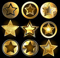 Set of military gold stars shining on a black background Royalty Free Stock Photo