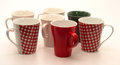 Set of mugs white checkered and green Royalty Free Stock Photos