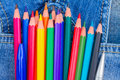 Set of multicolored pencils in blue jeans pocket close up Stock Photography