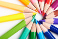Set of multicoloured pencils lying on white table round order creativity art skill and school variety possibilities game Stock Photo
