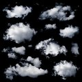 Set of multiple clouds isolated and cloud formations against the black background Royalty Free Stock Photos