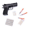 Set of narcotics and handgun isolated over white Stock Image