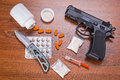Set of narcotics and handgun on wooden table Royalty Free Stock Photos