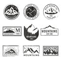 Set of nine mountain travel emblems with grunge texture. Camping outdoor adventure emblems, badges and logo patches