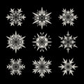 Set of Nine Vector White Semi Transparent Snowflake Shape Design Elements on Black Background Royalty Free Stock Photo