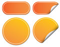 Set of orange stickers blank partially peeled with copy space white background Stock Images