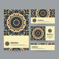 Set of ornamental business cards with flower mandala in dark col