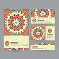Set of ornamental business cards with flower mandala in orange,