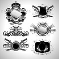 Set of ornamental labels shields decorated floral elements and arms this illustration may be useful as designer work Stock Photo