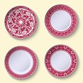 Set of ornamental porcelain dishes with red ethnic pattern in the style of Chinese painting on porcelain. Royalty Free Stock Photo