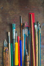 Set of paint brushes and office supplies on the table Stock Photos