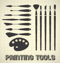 Set of painting tools with brushes palette and knives Stock Photography