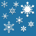 Set of paper snowflakes nine christmas decorations cut from Royalty Free Stock Photography