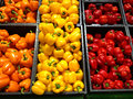Set peppers orange yellow and red lying in boxes in supermark of supermarket Royalty Free Stock Photography