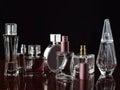 Set of perfumes over dark Royalty Free Stock Photos