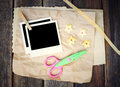 Set of photo frame scissors and crumpled paper on wooden background Stock Photography