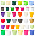 Set of plastic flowerpots colorful on white background Stock Photos