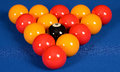 Set of pool balls arranged in a triangle at the start the frame on a blue baize table Stock Photo